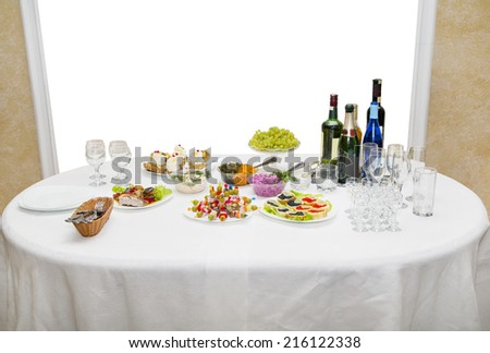 buffet table for fruit, sandwiches, fresh herbs, wine and champagne - stock photo