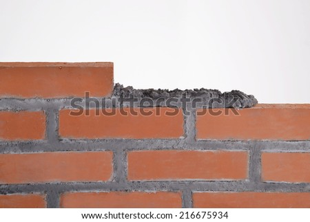 Building a wall.building brick block wall - stock photo