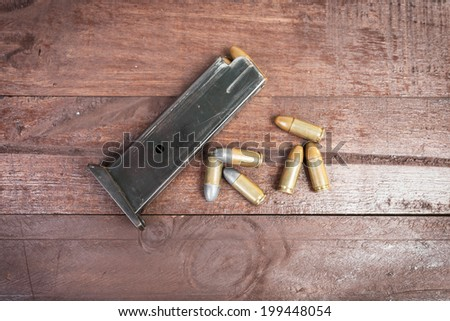 6 Bullets and loaded magazine isolated  - stock photo