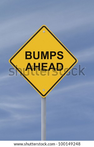 """Bumps Ahead"" road sign with a blue sky background - stock photo"