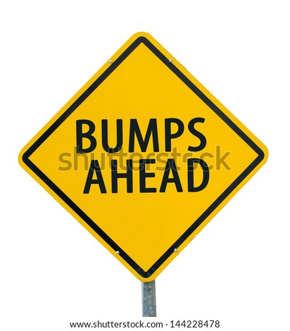 """BUMPS AHEAD"" traffic sign isolated on white background - stock photo"