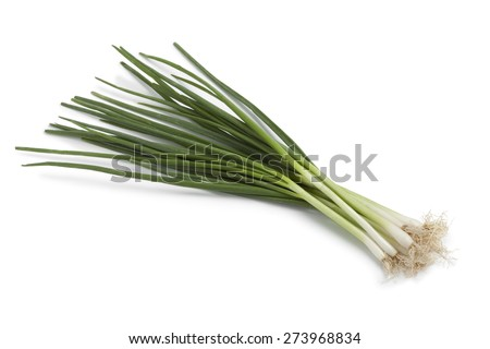 Bunch of fresh spring onions on white background - stock photo