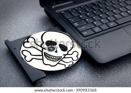 Burned pirated disc in notebook is ready - stock photo