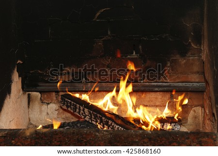 ,burning wood in the fireplace