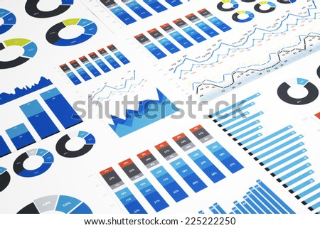 Business charts and diagrams printed on paper. - stock photo