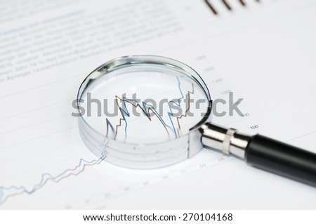 Business concept - Loupe and Charts, toned image. - stock photo
