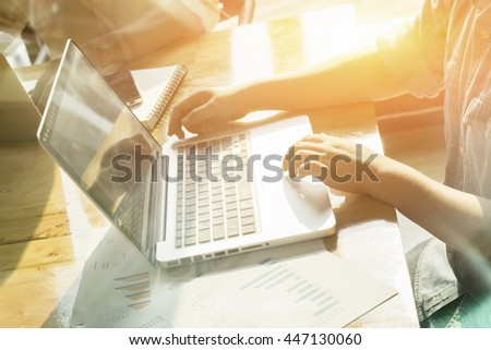 business documents on office table with smart phone and laptop computer and graph financial with social network diagram and people  discussing data ,vintage color,selective focus - stock photo
