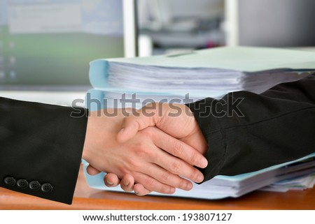 ?Business handshake with office background
