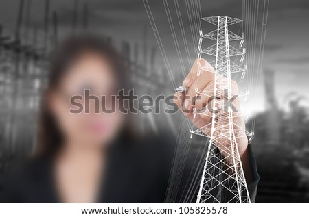 Business Lady drawing High voltage power pole line. - stock photo