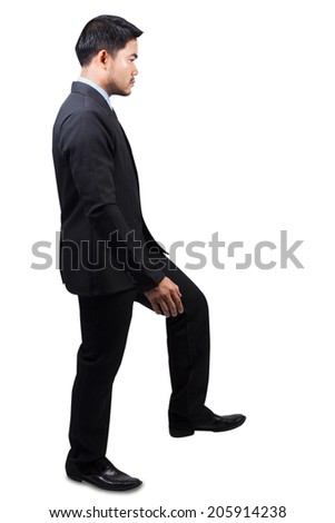 business man going up ladder in full body idea concept for creativity isolated on white background with clipping path