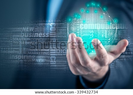 Business man  holding abstract earth globe,  concept - global business - stock photo