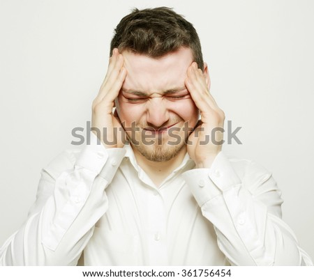 business man  with a headache or problem - stock photo