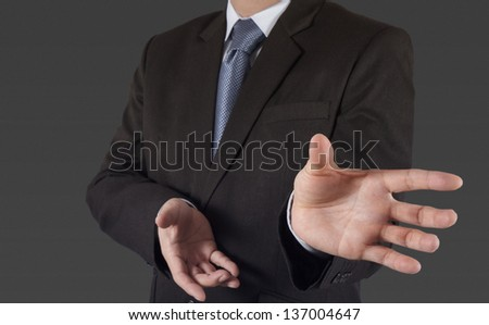 business man with an open hand as showing something concept