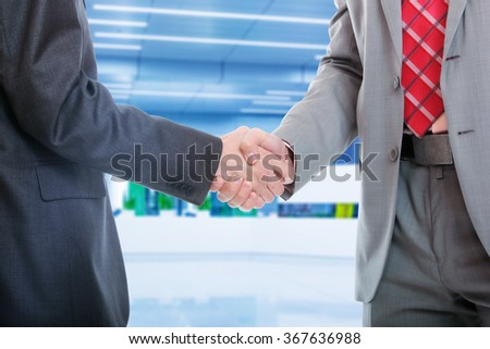 business man with an open hand ready to seal a deal - stock photo