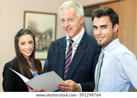 Business people in their office - stock photo