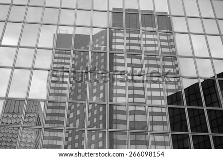 Business skyscrapers, sunny blue sky. La Defense financial distr. black and white photo - stock photo