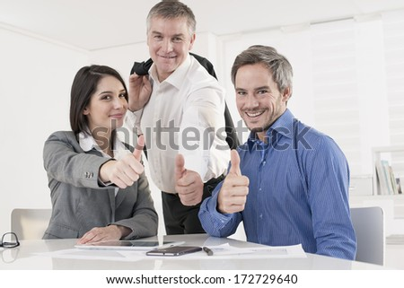 business team at office showing ok - stock photo