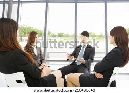 business team meeting in the office with beautiful background - stock photo