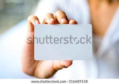 Business woman hand showing business card. - stock photo