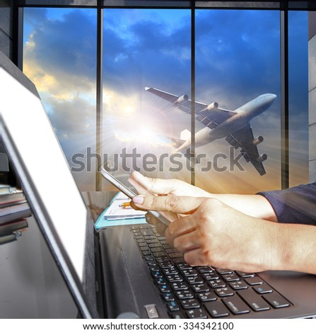 Business woman hand working on  laptop computer with air plane travel or import export shipping service concept - stock photo