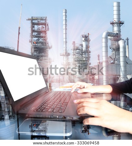 Business woman hand working on  laptop computer with oil refinery industry in metallic color style use as metal style of heavy industry background - stock photo