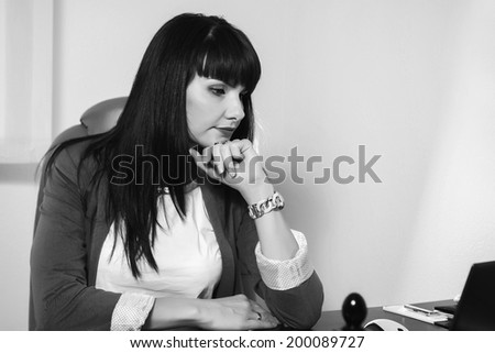 Business woman working on the computer in the office.Black and white
