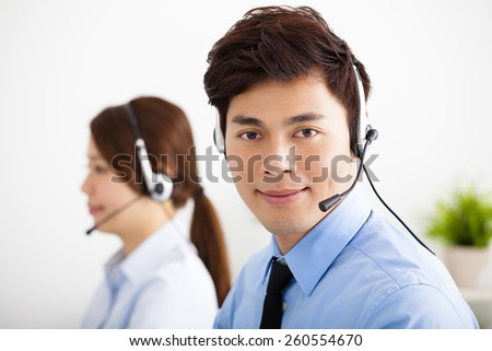 businessman and businesswoman with headset working in office - stock photo