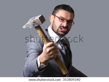 businessman angry and nervous hit with hammer