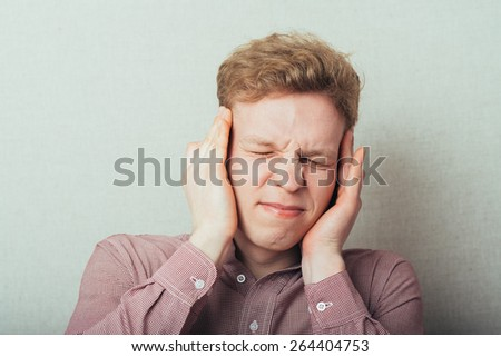 businessman covering his ears with his hands, closing eyes