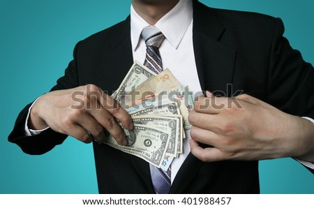 Businessman Displaying a Spread of Cash