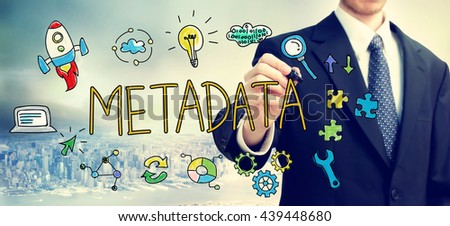 Businessman drawing Metadata concept above the city - stock photo
