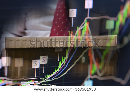 businessman hand point on stock chart, business analysis by good vision management.  business profit growth leading. - stock photo