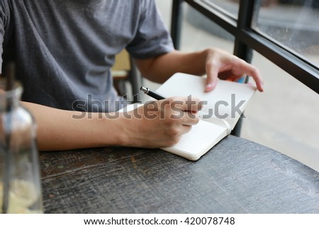 businessman hand write pen on paper ,hand writing pen on paper page,hardworking for achievement business target concept, write idea by pen. - stock photo
