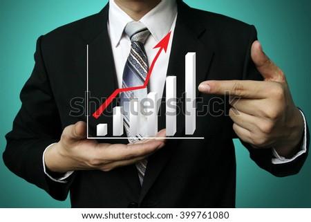 businessman hold graph on hand, Closeup image of businessman drawing graph,business strategy as concept - stock photo