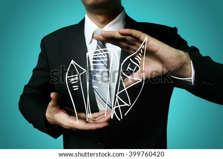businessman hold high building,businessman hand working with new modern computer and business strategy  concept, businessman show profit growth achieve target