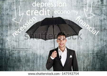 Businessman holding an umbrella protect from problems - stock photo