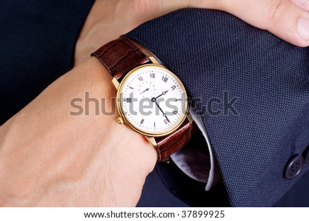 Businessman look his watch
