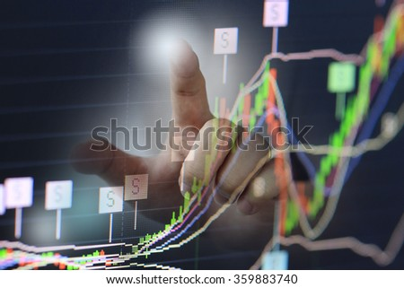 businessman pen point stock chart growing up with money, business and economic news background. business profit analysis trend and future.