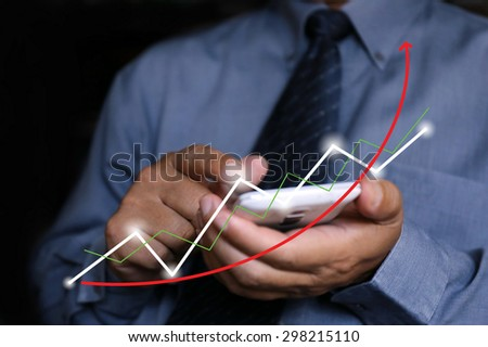 businessman pointing graph chart - stock photo