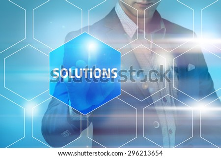Businessman pressing solutions button on virtual screens. Business, technology, internet and networking concept. - stock photo