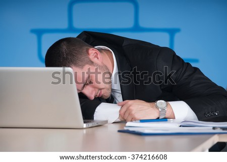 businessman sleeping head on laptop in his office