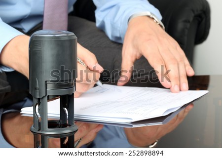 Businessman working with Documents in the office . Closeup view of  Seal  - stock photo