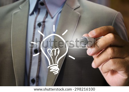 businessman write idea lightbulb - stock photo