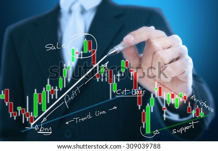 businessman writing candle stick graph pattern - stock photo