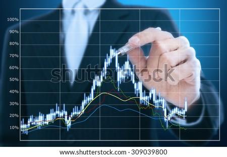 businessman writing graph pattern - stock photo