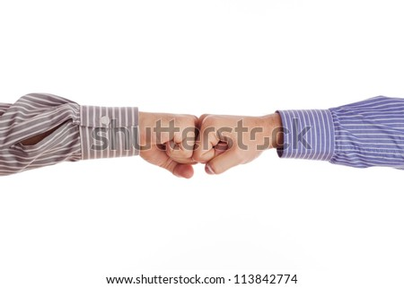 Businessmen greet with fists isolated on white. - stock photo
