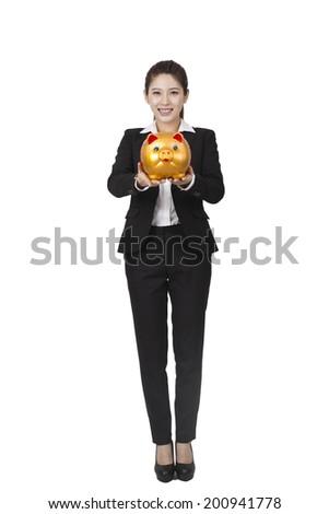 Businesswoman holding a piggy bank - stock photo