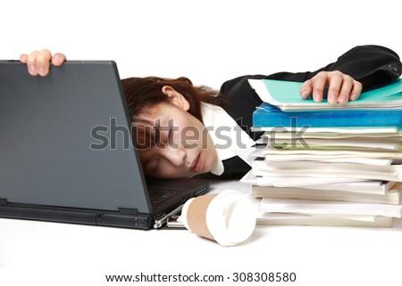 businesswoman sleeping on the desk - stock photo