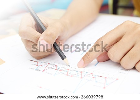 Businesswoman Studying Graph In Office