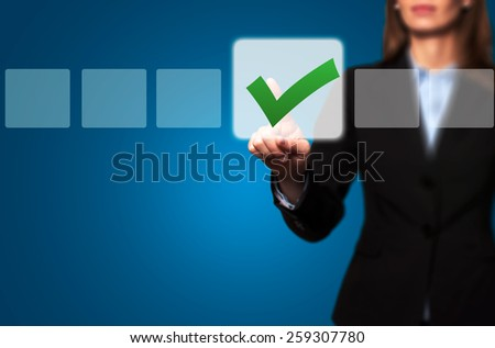 Businesswoman Touching Button and Ticking Check Box - stock photo
